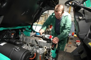 Man working in engine - Building services - Northern Bear PLC