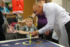 Keith Soulsby takes part in a painting session with children at St Oswald's Hospice