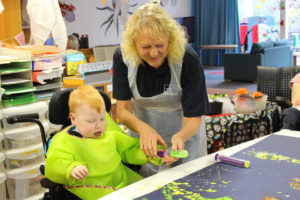 Wendy Edgell takes part in a painting session with children at St Oswald's Hospice
